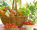 Fresh fruit i vegetables in wicker basket Stock Photo