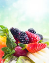 Fresh fruit with mint focus on a strawberry Royalty Free Stock Photos