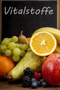 Fresh Fruit, Orange, apple, banana, pear, grapes against blackboard Royalty Free Stock Photo