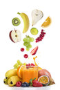 Fresh fruit over glass of multi vitamine juice Royalty Free Stock Photo