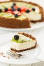 Fresh fruit pie cheesecake with kiwi blueberry and strawberry on a plate Royalty Free Stock Images