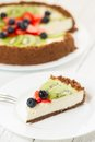 Fresh fruit pie cheesecake with kiwi blueberry and strawberry on a plate Stock Image