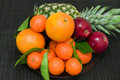 Fresh fruit pineapple, tangerines, oranges, apples Stock Photo
