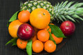 Fresh fruit pineapple, tangerines, oranges, apples Stock Image