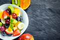 Fresh fruit salad for a healthy diet overhead view of bowl of made with assorted tropical fruits and an apple kiwifruit and Stock Image