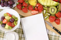 Fresh fruit salad selection background, cream, notebook, copy space Royalty Free Stock Photo