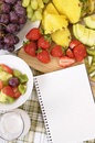 Fresh fruit salad selection vertical, notebook, recipe book, copy space Royalty Free Stock Photo