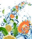 Fresh fruit in water splash with ice cubes Stock Image