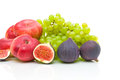 Fresh fruit on a white background close up figs green grapes and nectarines Stock Images