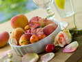 Fresh fruits in bowl with butterfly Stock Photography