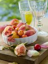 Fresh fruits in bowl with butterfly Royalty Free Stock Image