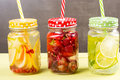 Fresh fruits flavored water in jars Royalty Free Stock Photo