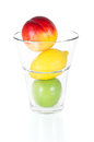 Fresh fruits in glass isolated on white and tasty background Stock Image