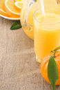 Fresh fruits juice in glass and orange on wood Royalty Free Stock Images