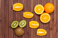 Fresh fruits kiwi, orange isolated on wooden background. Healthy food. A mix of fresh fruit. Group of citrus fruits. Royalty Free Stock Photo