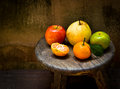Fresh fruits on an old wood chair still life orange pear and apple Royalty Free Stock Photo