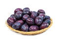 Fresh fruits plums in a wicker dish. Royalty Free Stock Photo