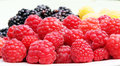 Fresh fruits red raspberries and other berries Royalty Free Stock Photo