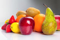 Fresh fruits selection over gray background Stock Photos