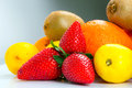 Fresh fruits selection over gray background Stock Image