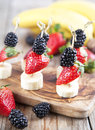Fresh fruits on the skewers. Royalty Free Stock Photo