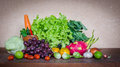 Fresh fruits and vegetables many on table Stock Photography