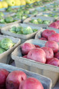 Fresh fruits and vegetables for sale at farmer s market including red potatoes brussel sprouts apples are lined up in bins on a Royalty Free Stock Photography