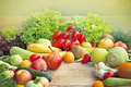 Fresh fruits and vegetables on a table Royalty Free Stock Images