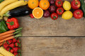 Fresh fruits and vegetables on wooden board with copyspace Royalty Free Stock Photo