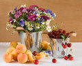 Fresh fruits and wild flowers Royalty Free Stock Photo