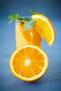 Fresh and fruity brew with oranges on the wooden table Stock Photo