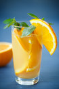 Fresh and fruity brew with oranges on the wooden table Stock Photography