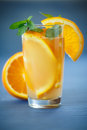 Fresh and fruity brew with oranges on the wooden table Stock Photos