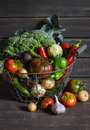 Fresh garden vegetables - broccoli, zucchini, eggplant, peppers, beets, tomatoes, onions, garlic - in vintage metal basket Royalty Free Stock Photo