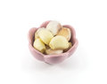 Fresh garlic isolated in pink cup on white background Royalty Free Stock Photography