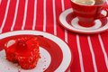 Fresh gelled cake plate red tea striped tablecloth Stock Image