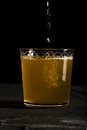 Fresh ginger beer dark photo with splashes closeup macro Royalty Free Stock Photo