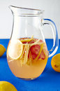 Fresh ginger lemonade with strawberry in pithcer Royalty Free Stock Photo