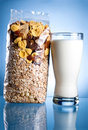 Fresh Glass of Milk and Closed Pack of muesli Royalty Free Stock Photos
