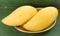 Fresh golden mango in basket on wood table Stock Photography
