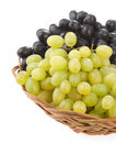 Fresh grape fruits and wicker basket plate Royalty Free Stock Photography