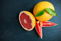 Fresh grapefruit on black stone placed shot from aerial view Royalty Free Stock Photos