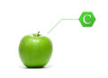 A fresh green apple with a vitamin c letter and tasty the pointer isolated on white Royalty Free Stock Image