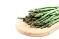 Fresh green asparagus on a wooden cutting board. Royalty Free Stock Photo