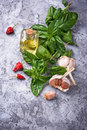 Fresh green basil with garlic and olive oil