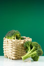 Fresh green broccoli wicker basket Royalty Free Stock Photos