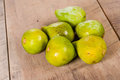 Fresh green figs picked ripe on a table freshly wooden Stock Image