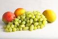 Fresh green grapes and mangoes Royalty Free Stock Photo