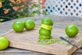 Fresh green limes on wooden old table ripe Stock Image