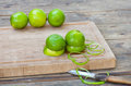 Fresh green limes on wooden old table ripe Stock Photos